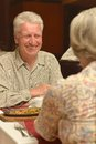 Couple having a dinner senior at restaurant Royalty Free Stock Images