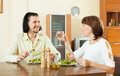 Couple having dinner with vegetables in sweet home Royalty Free Stock Photo