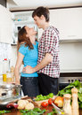Couple having flirt at kitchen loving home Stock Images