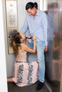 Couple having foreplay in lift Royalty Free Stock Photo