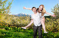 Couple having fun around bloomy trees Royalty Free Stock Photos