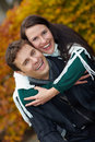Couple having fun in autumn Stock Photos