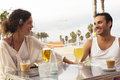Couple having fun in a bar friends beach looking at the camera Royalty Free Stock Image
