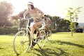 Couple having fun by bike on holiday to the lake