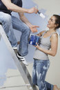 Couple Having Fun While Painting Unrenovated House Royalty Free Stock Photo