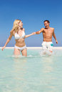 Couple having fun sea beach holiday smiling Royalty Free Stock Photo