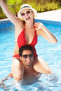 Couple Having Fun In Swimming Pool Royalty Free Stock Photo