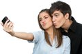 Couple having fun taking self portrait. Royalty Free Stock Photo