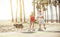 Couple having fun with their dog. Royalty Free Stock Photo