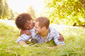 Couple having fun together in the countryside looking at each other Stock Photos