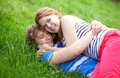 Couple having fun together in park Stock Images