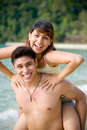 Couple having fun at the tropical beach Royalty Free Stock Images