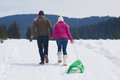 Couple having fun and walking in snow shoes Royalty Free Stock Photo