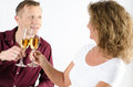 Couple having a glass of champagne and cheering Stock Image