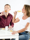 Couple having a glass of champagne sitting at table Stock Photo