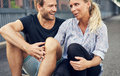 Couple having a good time while sitting on the ground Royalty Free Stock Images