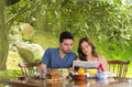Couple having healthy breakfast at home eating cereals drinking coffee and reading newspaper this image has attached release Royalty Free Stock Photos