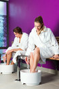 Couple having hydrotherapy water footbath man and woman in spa setting Royalty Free Stock Photos