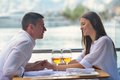 Couple having lanch at beautiful restaurant happy young on the beach Stock Photography