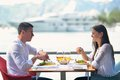 Couple having lanch at beautiful restaurant happy young on the beach Royalty Free Stock Image