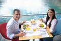 Couple having lanch at beautiful restaurant happy young on the beach Royalty Free Stock Images