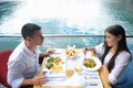 Couple having lanch at beautiful restaurant happy young on the beach Stock Images