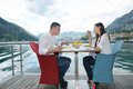 Couple having lanch at beautiful restaurant happy young on the beach Stock Photo