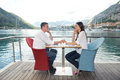 Couple having lanch at beautiful restaurant happy young on the beach Royalty Free Stock Photos