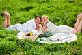 Couple having picnic happy young making in the park Stock Photo