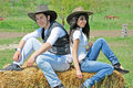Couple on a hay bale Stock Photography