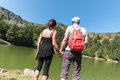 Couple on hike hand in hand