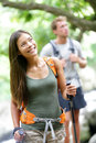 Couple hiking in forest during travel maui hawaii happy women hiker looking at beautiful nature landscape while trekking traveling Stock Photo