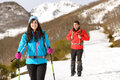 Couple hiking in snowy mountain winter on man and women walking and exploring nature on adventure travel Stock Photos