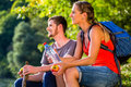 Couple hiking in summer drinking water Royalty Free Stock Photo