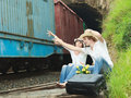 Couple hitch-hiking Royalty Free Stock Photography