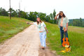Couple hitchhiker hippie on the road with guitar Stock Images