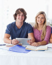 A couple hold a tablet together Stock Images