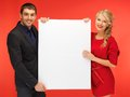 Couple holding big blank board bright picture of Royalty Free Stock Image
