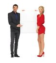 Couple holding big blank board bright picture of Royalty Free Stock Photography