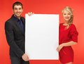 Couple holding big blank board bright picture of Stock Image