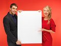 Couple holding big blank board bright picture of Royalty Free Stock Photos