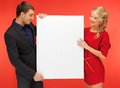 Couple holding big blank board bright picture of Stock Photos