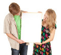 Couple holding blank billboard, poster Royalty Free Stock Photography