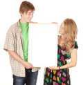 Couple holding blank billboard, poster Stock Photos