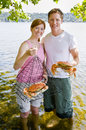 Couple holding crab Royalty Free Stock Photo