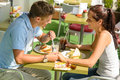 Couple holding hands flirting at cafe happy Stock Photography