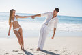 Couple holding hands and leaning to either side on the beach Royalty Free Stock Photography