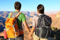 Couple holding hands looking at Grand Canyon Royalty Free Stock Photos