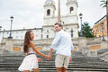 Couple holding hands on Spanish Steps, Rome, Italy Royalty Free Stock Image