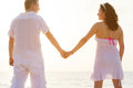 Couple holding hands together on the beach Royalty Free Stock Photos